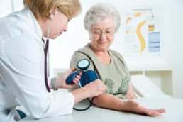 Blood pressure test for a senior woman