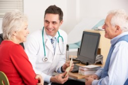 Senior doctor visit - older couple