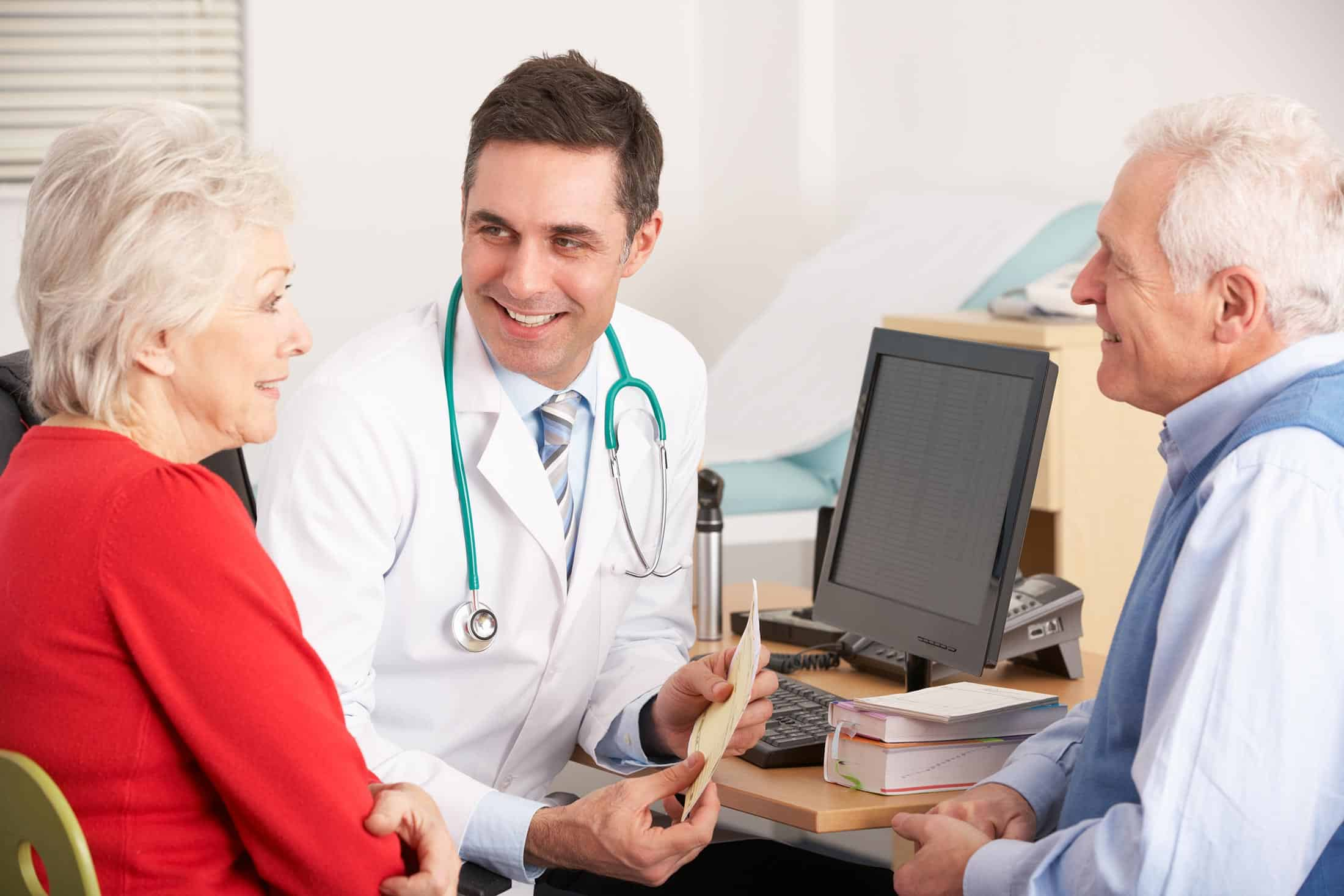 Senior doctor visit - older couple