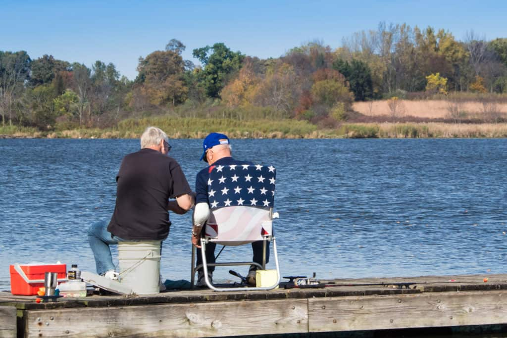 two old friends fishing on the dock